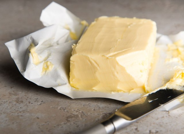 Softened butter with knife