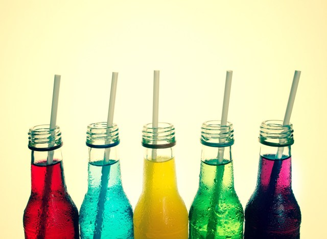 fruit flavored sodas in glass bottles with straws